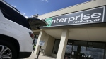 A vehicle with its' rear tailgate opened sits parked in front of a Enterprise Rent-A-Car location, Wednesday, Oct. 2, 2013, in Dallas. (AP / Tony Gutierrez)