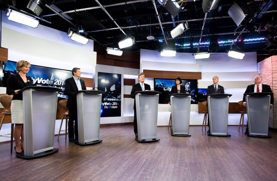 Karen Stintz, left to right, John Tory, moderator Gord Martineau, Olivia Chow, David Soknacki and Rob Ford take part in the first debate for the Toronto mayoral race in Toronto on Wednesday, March 26, 2014. (Nathan Denette / THE CANADIAN PRESS)