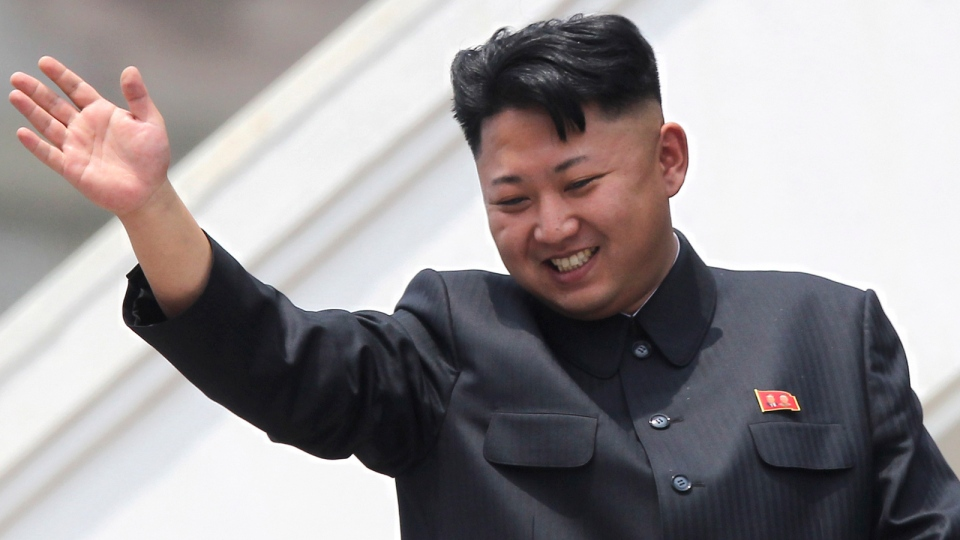 North Korean leader Kim Jong Un waves to war veterans during a mass military parade celebrating the 60th anniversary of the Korean War armistice in Pyongyang, North Korea, July 27, 2013. (AP / Wong Maye-E)