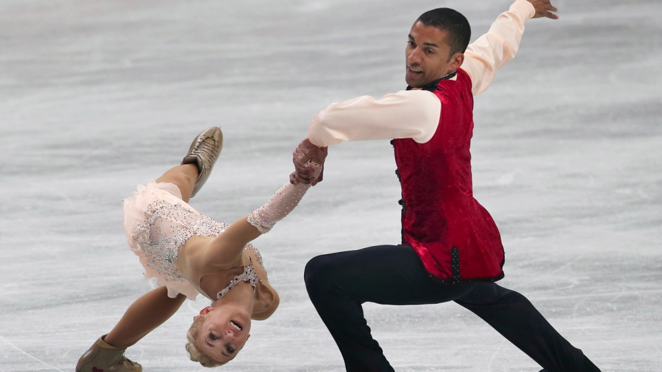 Aliona Savchenko and Robin Szolkowy of Germany perform during the pairs free skating in the World Figure Skating Championships in Saitama, near Tokyo, Thursday, March 27, 2014. (AP / Koji Sasahara)