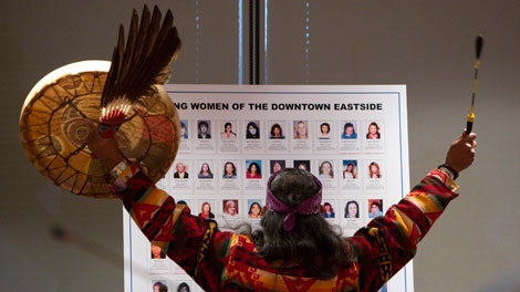 Elder Eugene Harry of the Squamish Nation performs a ceremonial blessing at the start of the missing women inquiry in downtown Vancouver, Tuesday, Oct. 11, 2011. THE CANADIAN PRESS/Jonathan Hayward