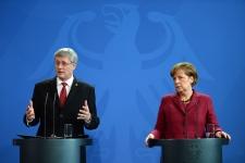 Stephen Harper and Angela Merkel speak in Berlin