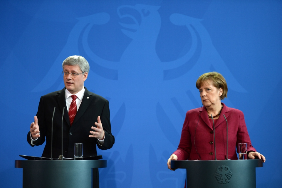 Prime Minister Stephen Harper takes part in a joint press conference with German Chancellor Angela Merkel at the Chancellery in Berlin on Thursday, March 27, 2014. (Sean Kilpatrick / THE CANADIAN PRESS)