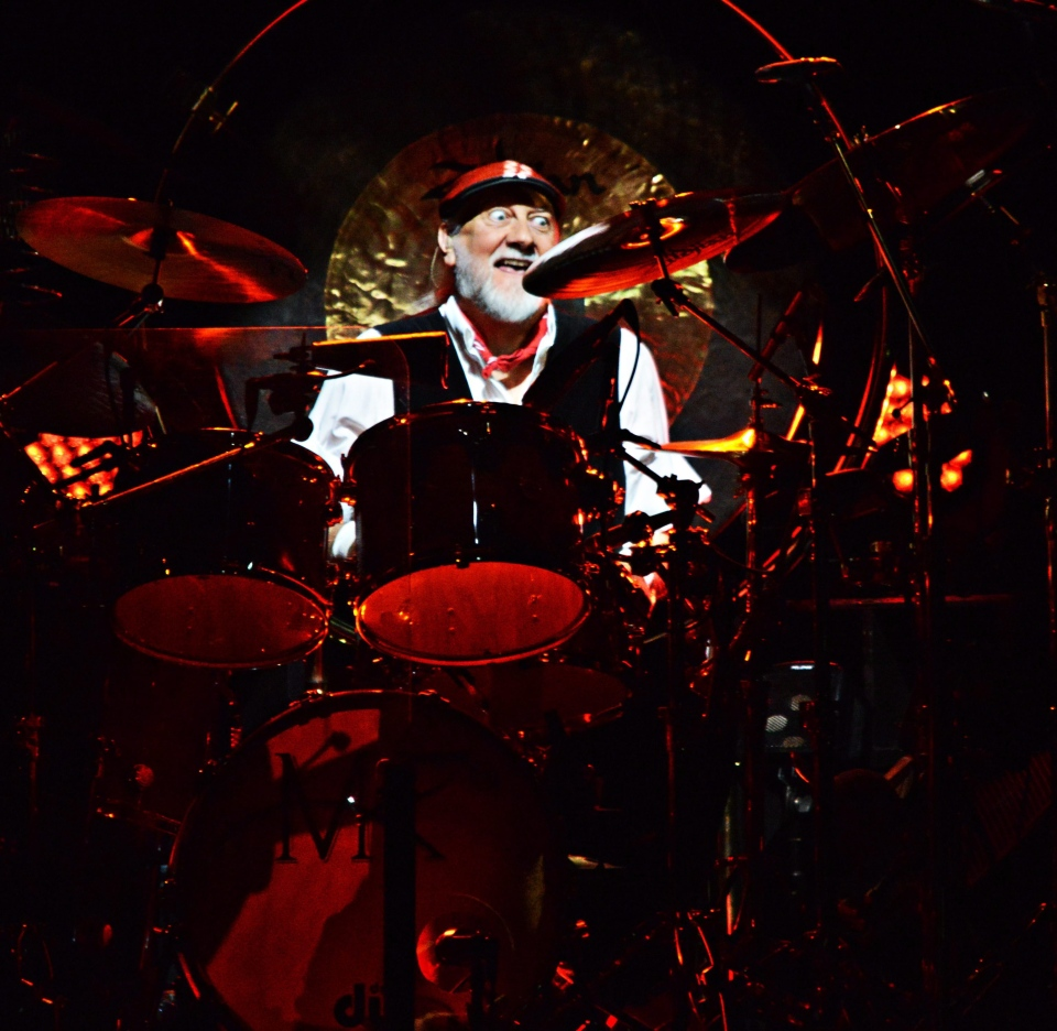 In this photo provided by the Las Vegas News Bureau, Mick Fleetwood performs as Fleetwood Mac takes the stage at the MGM Grand Garden Arena on Monday, Dec. 30, 2013, in Las Vegas. (AP / Las Vegas News Bureau, Bryan Haraway)