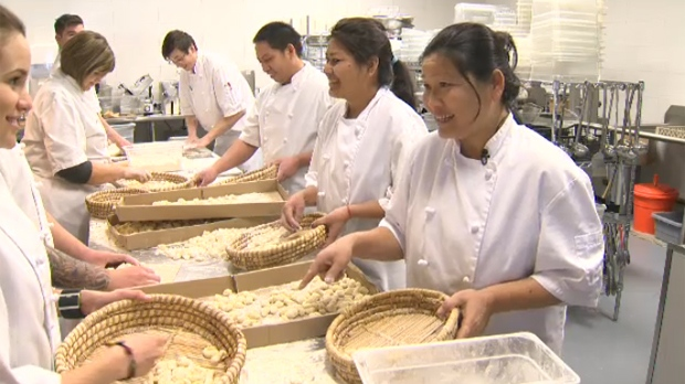 Tibetan immigrants work alongside their colleagues in the kitchen of the Wentworth location of Mercato