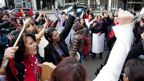 Women sing and chant outside of the missing women inquiry in downtown Vancouver, Tuesday, Oct. 11, 2011. Commissioner Wally Oppal has opened hearings to examine why police failed to stop Pickton as he murdered impoverished sex workers from Vancouver's Downtown Eastside. THE CANADIAN PRESS/Jonathan Hayward