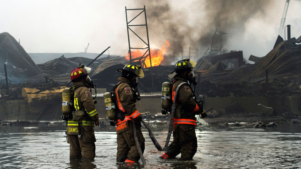 Firefighters battle a six-alarm fire at a mattress factory in Toronto on Thursday, March 27, 2014. (Nathan Denette / THE CANADIAN PRESS)