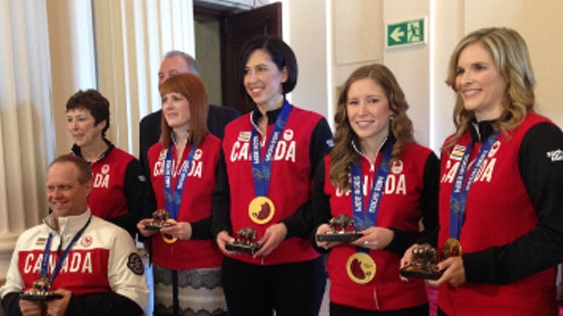 Janet Arnott is pictured here with paralympic champion Dennis Thiessen and Team Jennifer Jones as they were inducted into the Order of the Buffalo Hunt on March 27, 2014 in Winnipeg.