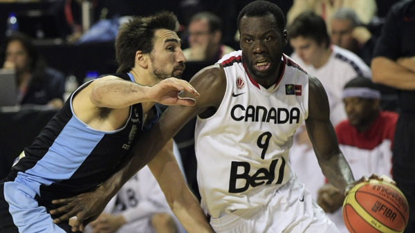 Canada's Denham Brown, right, dribbles around Uruguay's Martin Osimani during a FIBA Americas Championship basketball game, Wednesday, Sept. 7, 2011. (AP Photo/Martin Mejia)