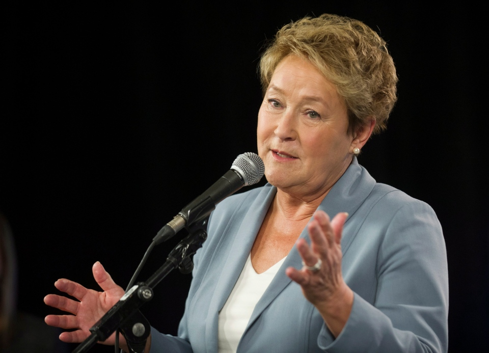 Parti Quebecois leader Pauline Marois speaks to reporters following a Quebec provincial election leaders debate in Montreal, Thursday, March 27, 2014. (Graham Hughes / THE CANADIAN PRESS)