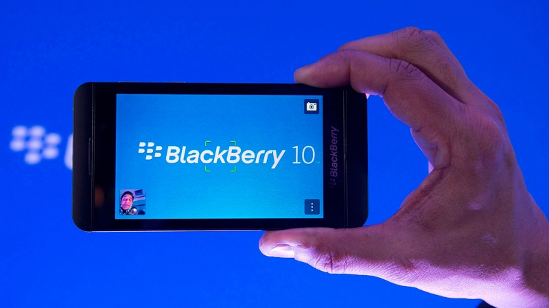 BlackBerry reported a steep drop in profit and revenue as it transitions from a smartphone company to a software business under its new chief executive on Friday, March 28, 2014.  (THE CANADIAN PRESS/Nathan Denette)