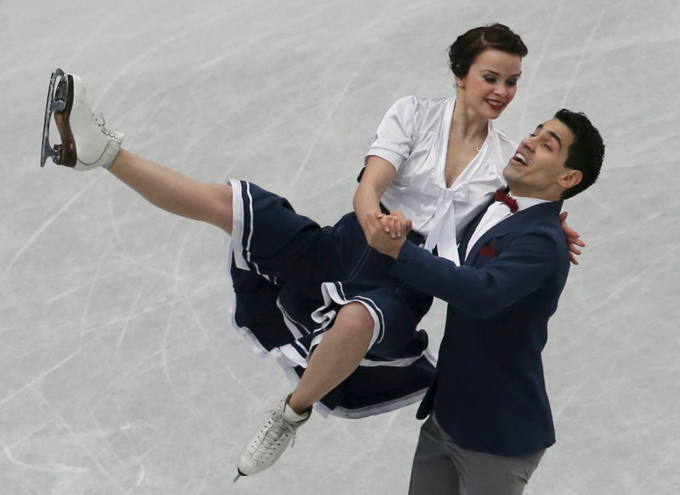 Anna Cappellini and Luca Lanotte of Italy perform during the ice dance short dance event of the World Figure Skating Championships in Saitama, near Tokyo, Friday, March 28, 2014. (AP / Koji Sasahara)
