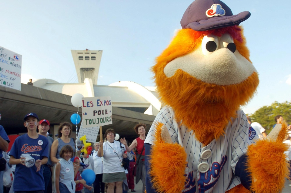 Montreal Expos fans cheer with team mascot Youppi before the game against Philadelphia Phillies in Montreal on Saturday Sept. 25, 2004. A few hundred Montreal Expos fans rallied Saturday in what they hope will be the equivalent of a successful ninth-inning comeback to keep their National League baseball team in the city. (CP PHOTO/Francois Roy)