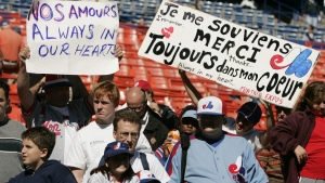 Montreal Expos fans show their support for the team before the Expos game against the New York Mets Sunday, Oct. 3, 2004 ,in New York. (AP Photo/Julie Jacobson)