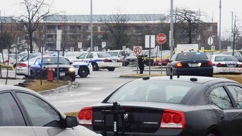 Police cruisers block off the parking lot of the Brampton, Ont. courthouse on March 28, 2014. (Andrew Collins / CTV Toronto)