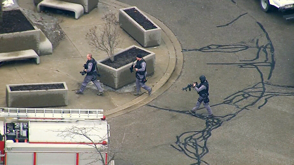 An aerial view of armed police officers at the scene of a shooting at a courthouse in Brampton, Ont., March 28, 2014.