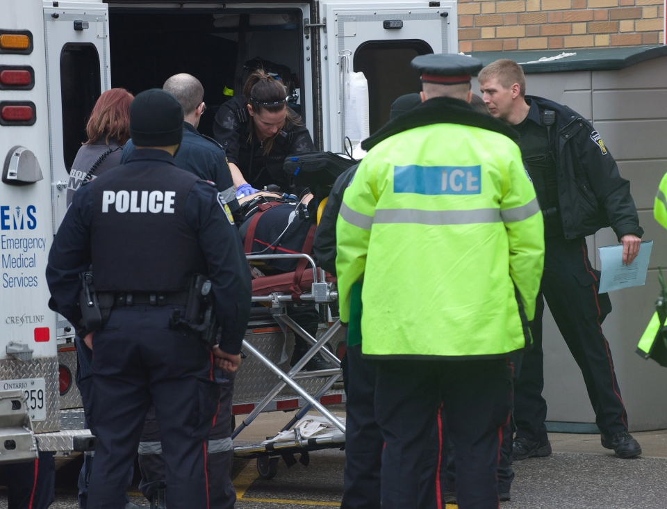 Peel Region paramedics rush a Peel Region police officer to Sunnybrook Hospital after he was shot at a Brampton courthouse, in Toronto on Friday, March 28, 2014. (Victor Biro / THE CANADIAN PRESS)