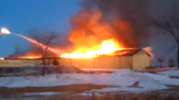 According to Pembina Valley Online, the fire broke out in a building at Winkler's Gateway Resources in the early evening. (Video still courtesy Pembina Valley Online)