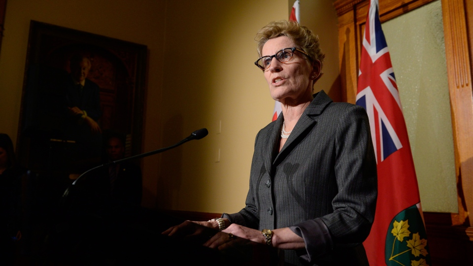 Ontario Premier Kathleen Wynne talks to media outside her office at Queen's Park in Toronto on Thursday, March 27, 2014. (Frank Gunn / THE CANADIAN PRESS)