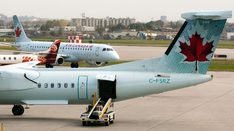 Air Canada planes land at Pierre Elliott Trudeau Airport