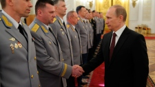 Vladimir Putin meets with Russian military brass