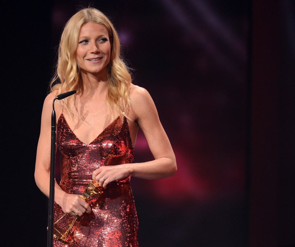 Gwyneth Paltrow poses with the award she received as best actress International, during the Goldene Kamera (Golden Camera ) media award event in Berlin, Germany, Saturday Feb. 1, 2014. (AP /  Britta Pedersen)