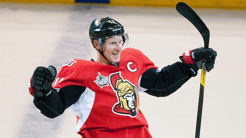 Ottawa Senators' Daniel Alfredsson celebrates after scoring the game winning goal in a shootout against the Minnesota Wild during NHL action in Ottawa Tuesday October 11, 2011. THE CANADIAN PRESS/Adrian Wyld