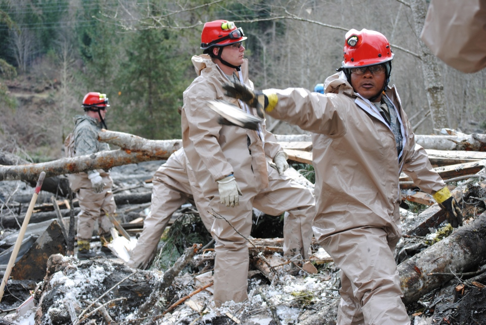 Members of the Washington Air National Guard continue a grid-based surface search from the west side of the mudslide near Oso, Wash on March 26, 2014 (AP Photo/Washington Air National Guard, Maj. Tawny Dotson)