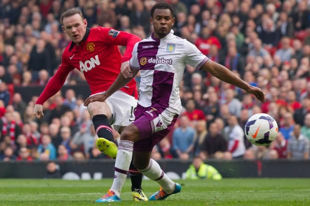 Man U's Wayne Rooney scores against Aston Villa