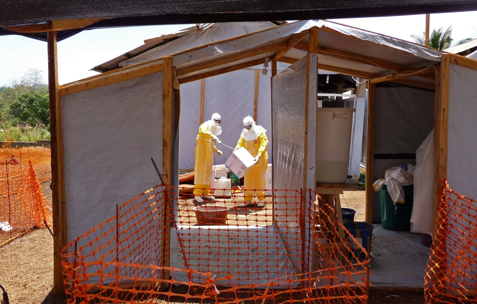 In this photo provided by Medecins Sans Frontieres, health-care workers prepare isolation and treatment areas for their Ebola operations in Gueckedou, Guinea on Friday, March 28, 2014. (Kjell Gunnar Beraas/MSF)
