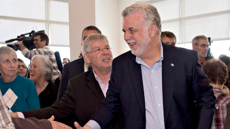 Quebec Liberal Party Leader Philippe Couillard is greeted by supporters at a local rally Saturday, March 29, 2014 in La Pocatiere Que. Local candidates Norbert Morin, behind, looks on. Quebecers are going to the polls on April 7. THE CANADIAN PRESS/Jacques Boissinot