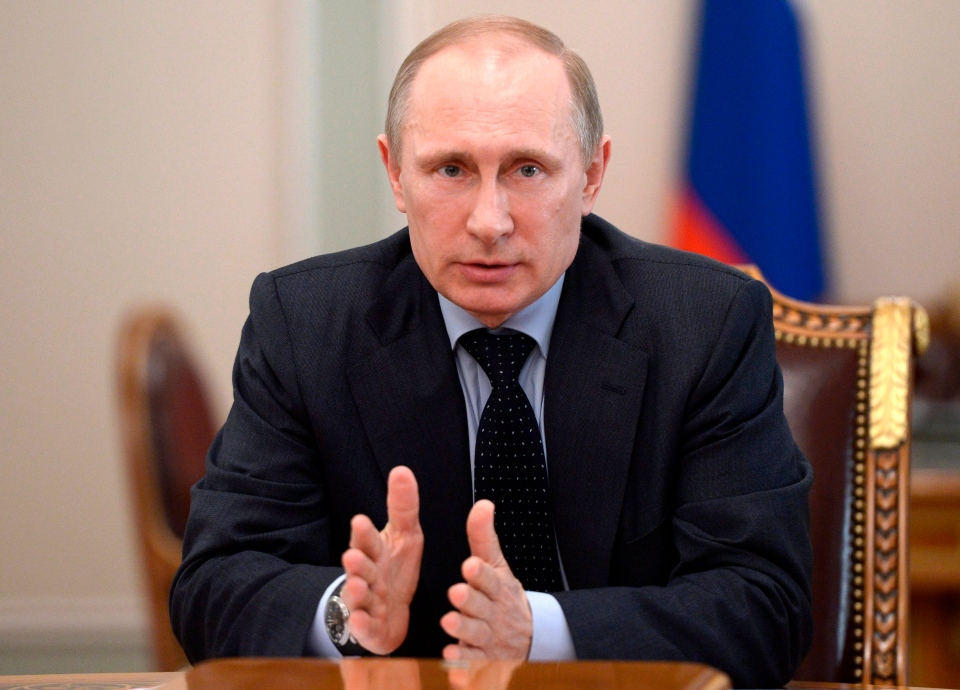 Russian President Vladimir Putin speaks at a Security Council meeting in the Kremlin in Moscow, Russia, Friday, March 28, 2014.(AP / RIA-Novosti, Alexei Nikolsky, Presidential Press Service)