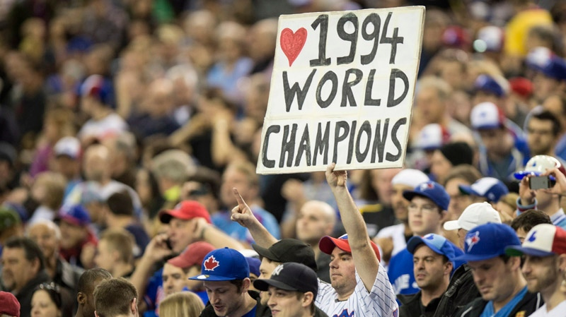 A fan shows his appreciation as members of the 1994 team are introduced prior to a pre-season game with the Toronto Blue jays facing the New York Mets Saturday, March 29, 2014 in Montreal. THE CANADIAN PRESS/Paul Chiasson