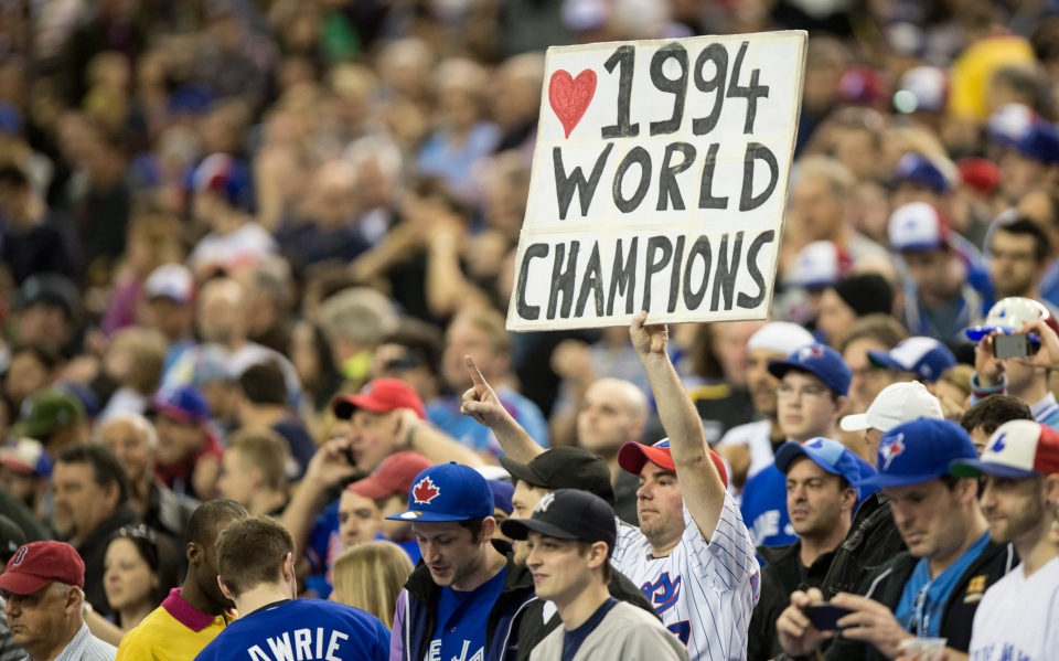 A fan shows his appreciation as members of the 1994 Montreal Expos are honored before an exhibition baseball game between the Toronto Blue Jays and the New York Mets in Montreal Saturday, March 29, 2014. (AP / The Canadian Press, Paul Chiasson)