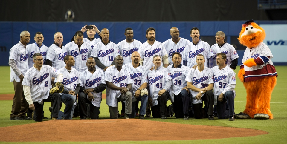 Members of the 1994 Montreal Expos pose for a photograph during a ceremony prior to a pre-season game with the Toronto Blue jays facing the New York Mets Saturday, March 29, 2014 in Montreal. (Paul Chiasson / THE CANADIAN PRESS)