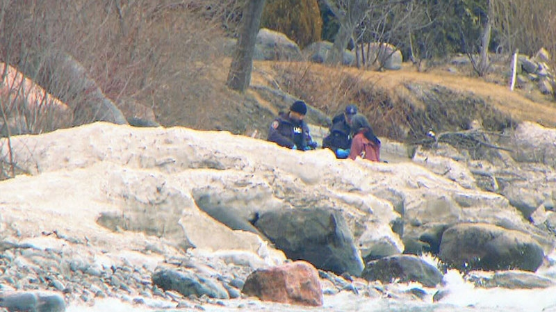 Police appear to be examining evidence along the shoreline of Lake Ontario on Saturday, March 29, 2014.