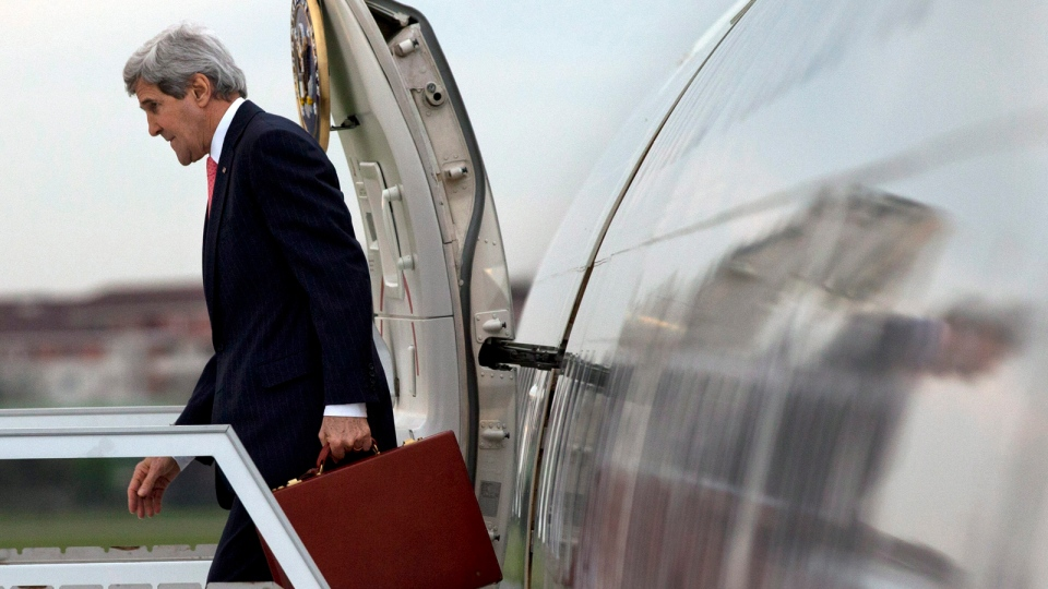 U.S. Secretary of State John Kerry arrives in Paris as the sun sets on Saturday, March 29, 2014. (AP / Jacquelyn Martin, Pool)