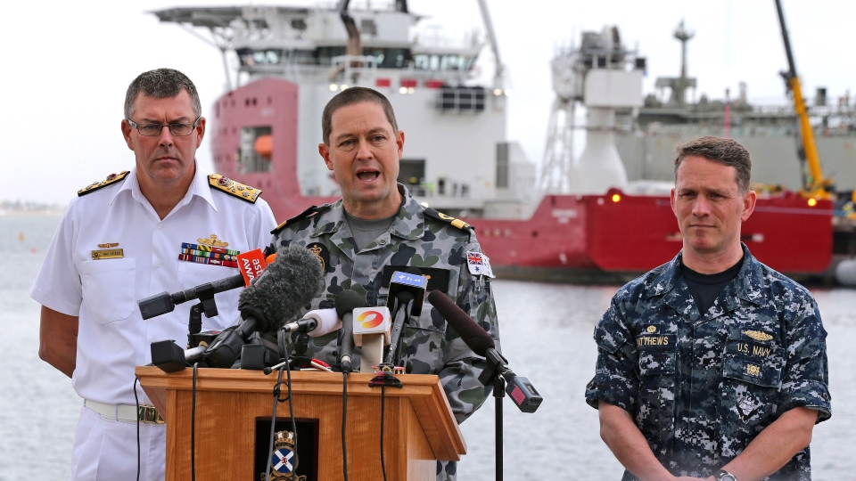 U.S. Navy Captain Mark Matthews right, Royal Australian Navy Commodore Peter Leavy commander of join task force 658, center, and Chief of the Navy Vice Admiral Ray Griggs speak at a press conference at naval base HMAS Stirling about the Defense ship Ocean Shield and her roll in the search for missing Malaysia Airlines Flight MH370 in Perth, Australia, Sunday, March 30, 2014. (AP / Rob Griffith)