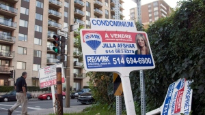 For sale signs stand in front of a condominium Tuesday, September 27, 2011 in Montreal. THE CANADIAN PRESS/Ryan Remiorz