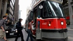 A TTC streetcar takes on passengers in downtown Toronto in this file photo from Sunday April 27, 2008. (J.P. Moczulski/The Canadian Press)