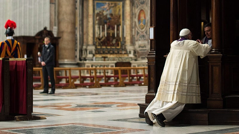 In this picture made available by the Vatican newspaper L' Osservatore Romano, Pope Francis is confessed by a priest in St. Peter's Basilica, at the Vatican, Friday, March 28, 2014. (AP Photo/L' Osservatore Romano)
