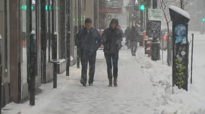 Residents of Montreal walk through snow on Sunday, March 30, 2014.(CTV)