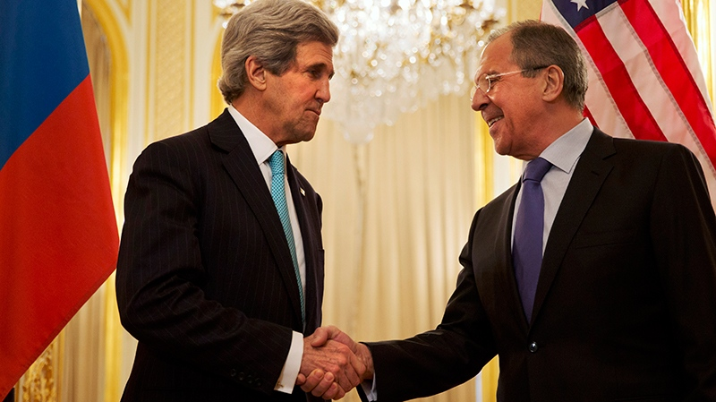 U.S. Secretary of State John Kerry, left, shakes hands with Russian Foreign Minister Sergey Lavrov before the start of their meeting at the Russian Ambassador's residence in Paris on Sunday March 30, 2014. (AP / Jacquelyn Martin)