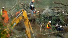 Washington mudslide search crews