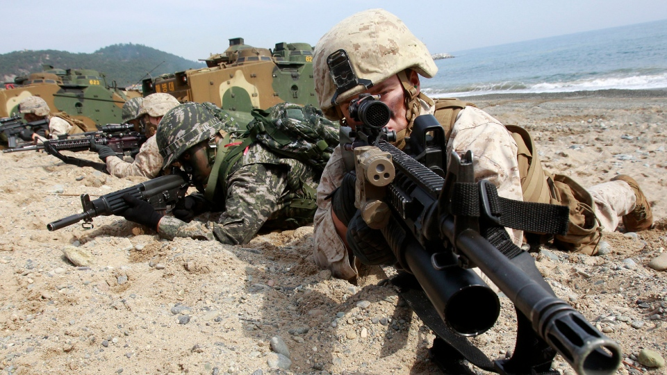 South Korean and U.S. Marines aim their machine guns during the U.S.-South Korea joint landing exercises called Ssangyong, part of the Foal Eagle military exercises, in Pohang, South Korea, Monday, March 31, 2014. (AP / Ahn Young-joon)