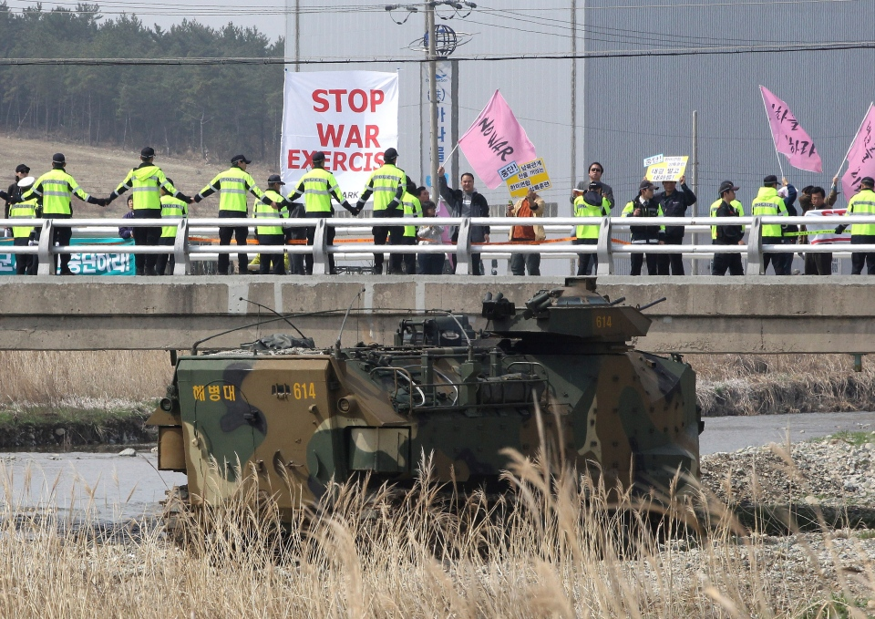Anti-war protesters stage a rally during the U.S.-South Korea joint landing exercises called Ssangyong as part of the Foal Eagle military exercises in Pohang, South Korea, Monday, March 31, 2014. (AP / Ahn Young-joon)