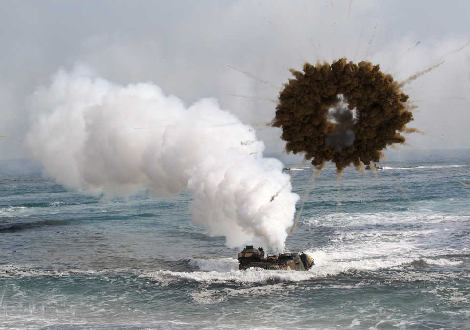 A South Korean marine LVT-7 landing craft sail to shores through a smoke screen during the U.S.-South Korea joint landing exercises called Ssangyong, part of the Foal Eagle military exercises, in Pohang, South Korea, Monday, March 31, 2014. (AP / Ahn Young-joon)