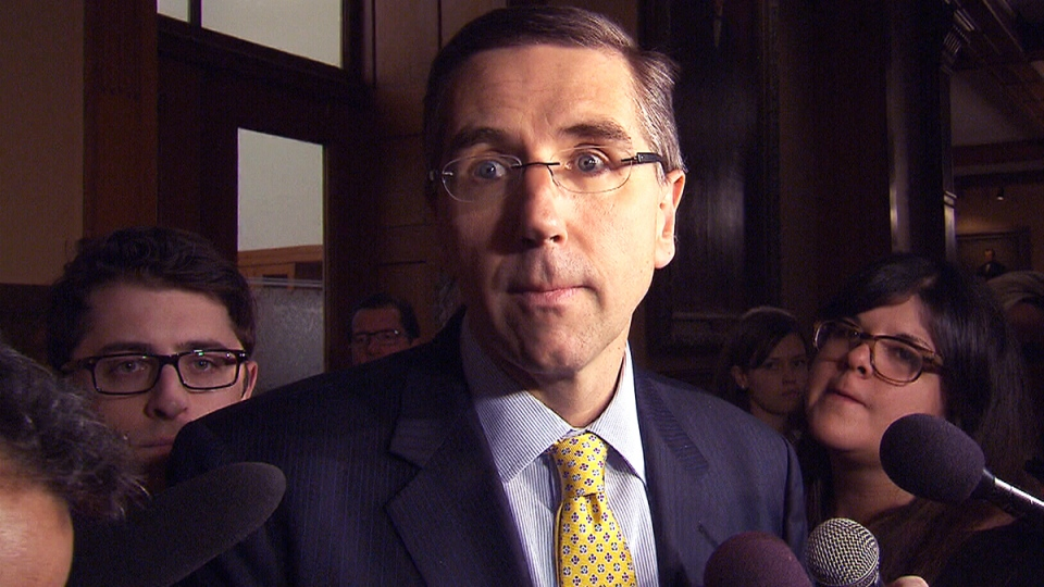Ontario Government House Leader John Milloy speaks to reporters at Queen's Park in Toronto, Thursday, March 27, 2014.