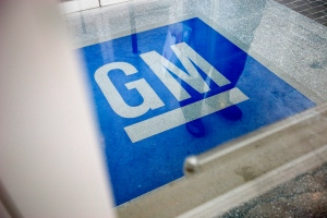 The logo for General Motors decorates the entrance at the site of a GM information technology center in Roswell, Ga., in this Thursday, Jan. 10, 2013 photo. (AP / David Goldman)
