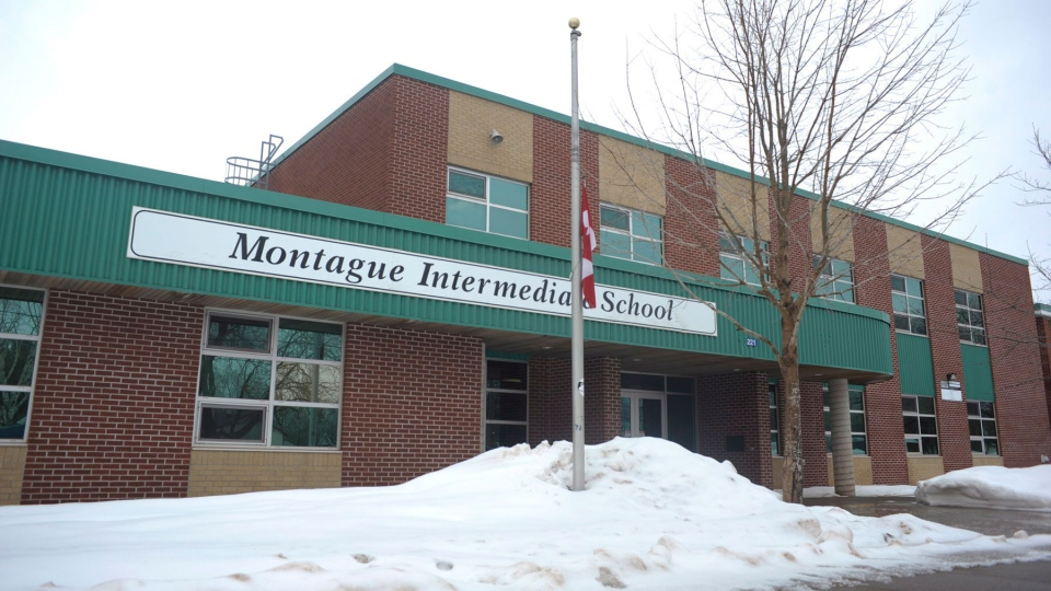 A Canadian flag flies at half-mast outside the Montague Regional High School in Montague, P.E.I., Monday, March 31, 2014. (Nathan Rochford / THE CANADIAN PRESS)